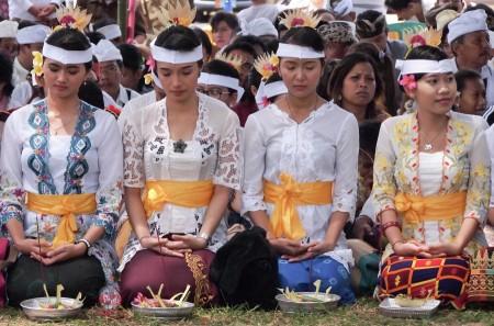 Attending melasti ceremony