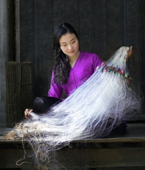 Preparing fish net for new season.