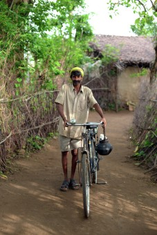 A village riding his cycle
