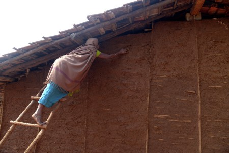 A woman trying to repair her house